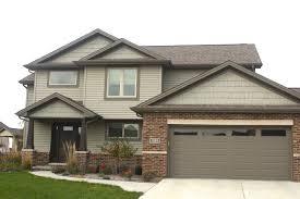 houses with dark brown garage doors wageuzi
