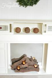 battery operated candles in log faux fireplace insert