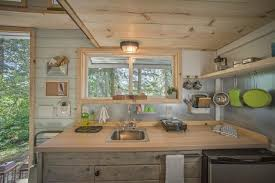 Small Picture 9 Teeny Tiny Kitchens Packed With Character HGTVs Decorating