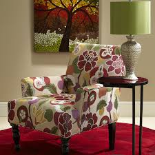colorful fl prints accent chair and end table with green shade table lamp on red rose tufted rug by pier 1 imports