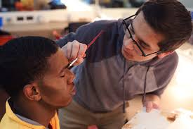 kendall jones learns how to apply his makeup for urinetown from christopher cruz head of