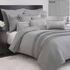 modern bedroom design ideas using gray duvet cover combine with black headboard ideas
