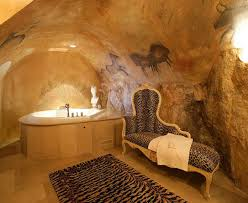 stone cave-like bathroom | awesome room, but ugly furniture and tub need to