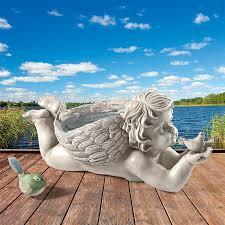 s messenger cherub with bird angel statue