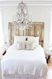 old doors into a headboard i want to do this for our guest bedroom just need to find doors love the chandelier