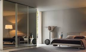 the arizona fitted wardrobe from cococucine features sliding doors in a smoked mirror finish s start from 800 per litre