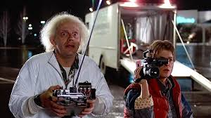 Back To The Future - It is a classic scientific comedy where the experiments of scientist go wrong and as a result, Marty goes back into past and meet his young parents. He tries his level best to make his parents fall in love so that he exists.