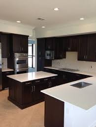 black kitchen cabinets with white countertops. Exellent Countertops White Quartz Countertops And Brown Dark Cabinets  Httpwwwstoneandquartzsurfaces Throughout Black Kitchen Cabinets With Countertops T