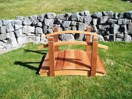 small garden bridge with wooden build