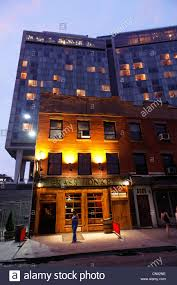 united states new york city manhattan meatng district standard hotel in the twilight 848 washington street brass