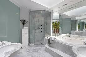 oval white porcelain freestanding bathtub small round wash basins for walls painted of grey bathroom light fixtures tile flooring master bathroom