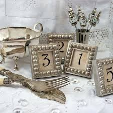 table numbers in silver boules mini frames for weddings events restaurants banquets