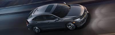 2018 honda civic hatchback.  2018 image of 2018 civic hatchback driving on highway for honda civic hatchback