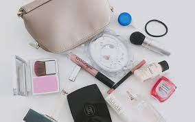 i m very excited to show you the contents of my makeup bag today these are my absolute makeup bag essentials that i like to carry around with me on a daily