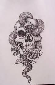 Guys gravitate towards the skull tattoo as a masculine and cool type of body from small and simple to skulls with roses, crowns, crossbones, pirates and flames, explore these cool tattoo ideas to find a drawing you'll love. Top 55 Best Skull Tattoos Designs And Ideas