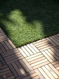interlocking patio tiles over grass flipping the block tour finished outdoor spaces wood parquet parquetry and