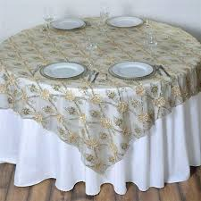 extravagant fashionista table overlays champagne lace netting round black wedding