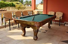 covered patio with a pool table