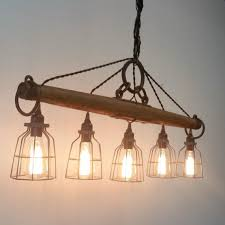 modern rustic lighting. this modern rustic chandelier featuring five lights is crafted from a genuine antique single lighting i