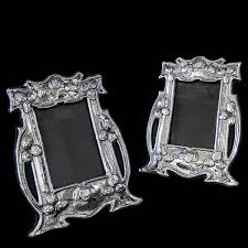 pair of sterling silver arts crafts photograph frames