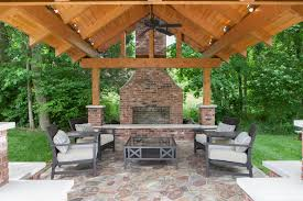 outdoor fireplace patio traditional with wood ceiling beams