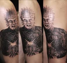 Pinhead Tattoo On Biceps