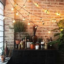 cozy string lights with brick exposed