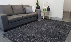 how to clean a wool rug black