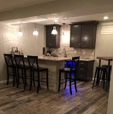 basement bar stone. Basement Bar With Stone Veneer Backsplash And Surround. Shaker Style Cabinets Pendant Lights