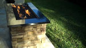 rectangular gas fire pit with fire glass granite and ledge stone
