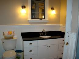 bathroom vanity black. Awesome Bathroom Vanity Ideas With White Wainscoting And Black Counter Top Plus Cabinets Also Wall Lamps Mirror Wood Door G