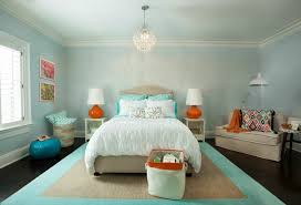 another feminine bedroom rich with blue hues and hints of some orange and grey here and