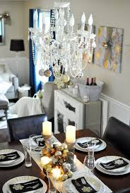 using garland to decorate a chandelier