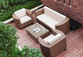 fabric cushions and pillows can be used to make a backyard look like an outdoor living room