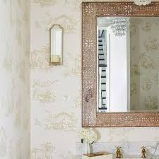 cream toile wallpaper with blue bath vanity