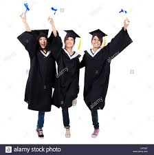 happy group of graduation girls holding their diploma stock photo  happy group of graduation girls holding their diploma