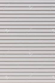 white garage door texture. Stock Photo - White Metal Roller Door Shutter Background And Texture Garage D