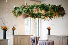 bows and arrows apryl ann photography fl chandelier of greenery and tropical flowers