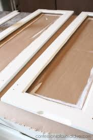 Diy glass cabinet doors Door Inserts Adding Glass To Kitchen Cabinet Doors 12 Confessions Of Serial Diyer How To Add Glass To Cabinet Doors