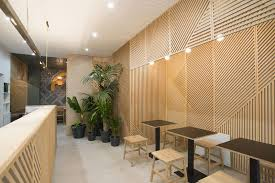 Attractive Wall Decor Idea   This Restaurant Covered Its Walls With Wood Panels That  Look Like Abstract