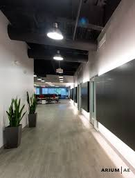 lighting for office space. corridor in an office space with black laminate accent wall light coves exposed ceiling painted vinyl woodlook floors pinterest lighting for