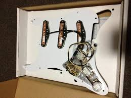 how easy is it to install a loaded pickguard seymour duncan turn it over and you ll see a really well wired up setup so much neater than what i could do myself so lets get onto it