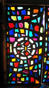 antique chunk rock stained glass with fleur de lis