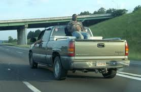 in most places the laws on riding in the back of a pickup truck ...