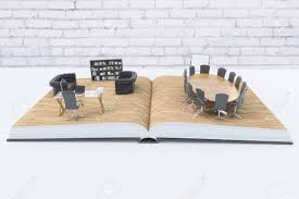 open book with abstract office interior on white desktop with white brick wall in the background