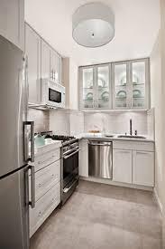 white subway wall tile backsplash and white kitchen cabinets storage also chrome appliance panels in white small kitchen