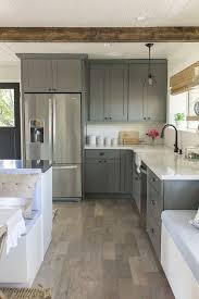 a wooden floor kitchen with graphite vintage grey kitchen cabinets in white countertops