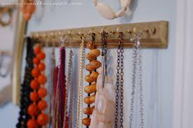 but for the necklaces, the smaller hooks are perfect, and there's plenty of  room to hang multiple necklaces from one hook: ...
