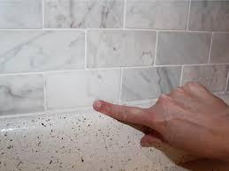 caulk between bottom backsplash tiles and countertop