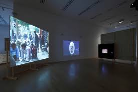 amal kenawy  exhibition view of arab express at the mori museum of art tokyo several videos by amal kenawy silence of the lambs can be seen on the far left